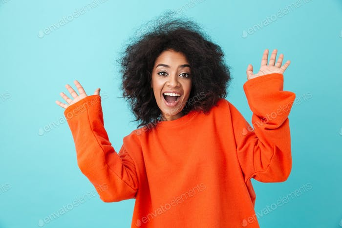Colorful portrait of happy woman in red shirt looking on camera