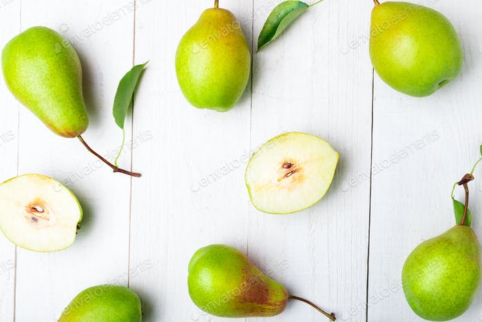 Pears background on white wooden table.