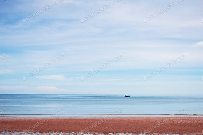 beach and boat on sea