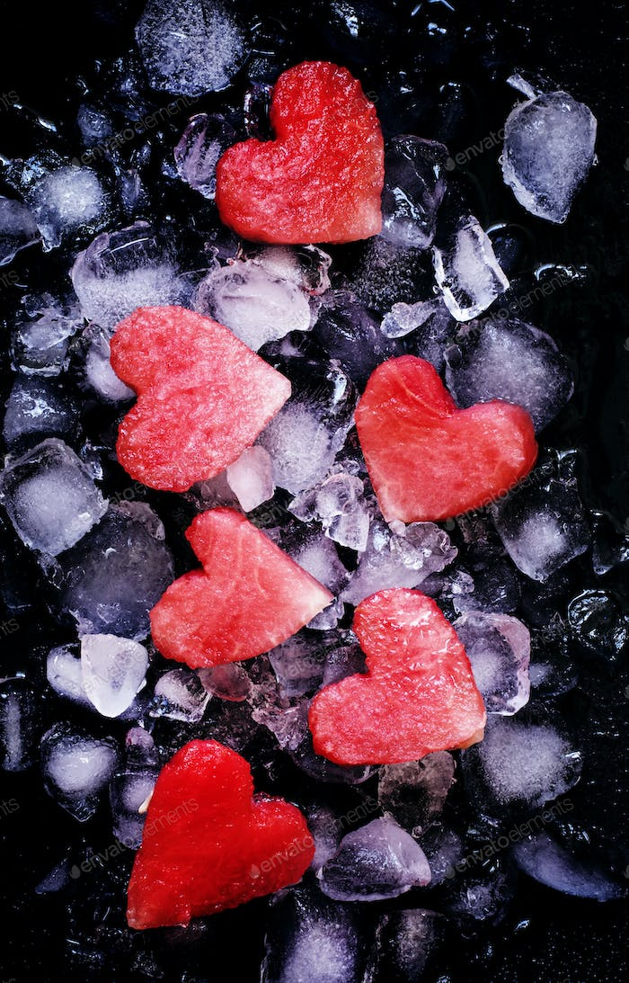 Sweet hearts of watermelon on crushed ice, top view
