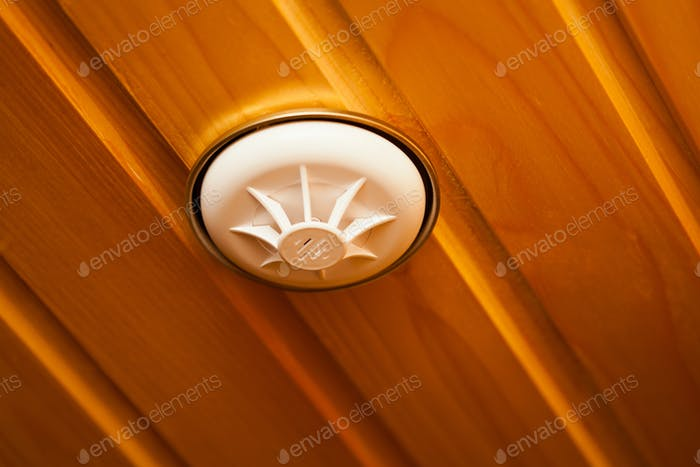 Smoke detector built into wooden ceiling