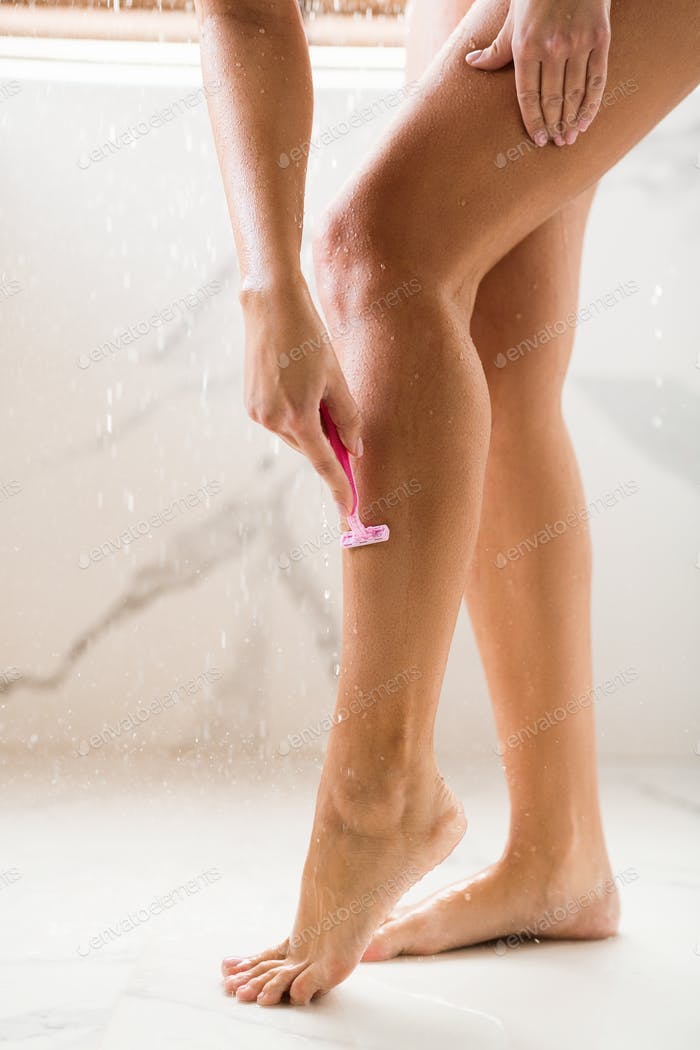 Woman Shaving Legs, Taking Shower In Hot Summer Day