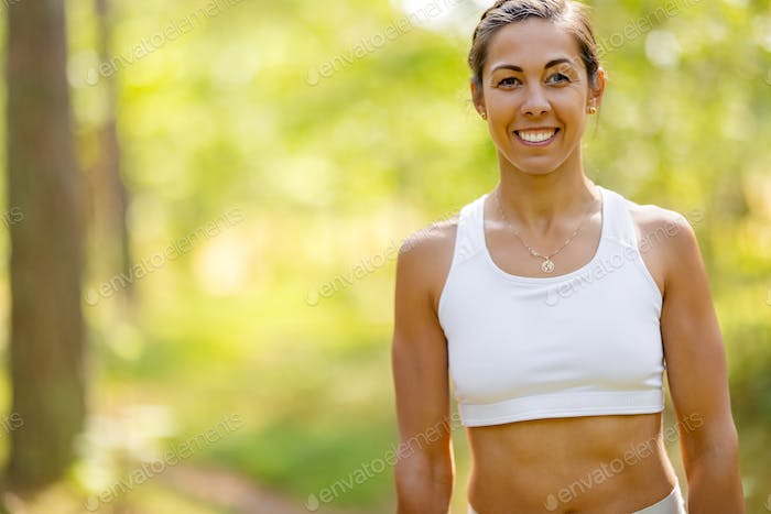 Female Athlete In Forest During Outdoor Workout