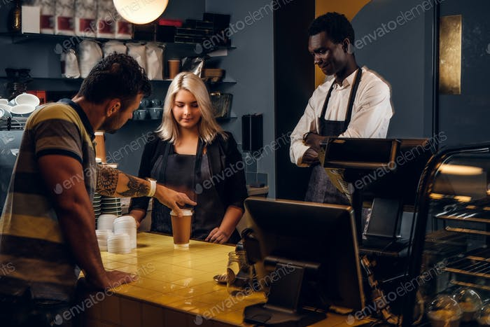 Customer picks up his order in a coffee shop or cafe