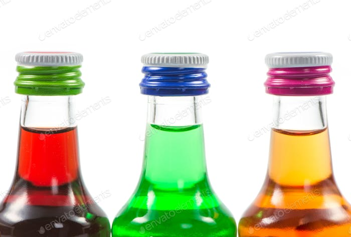 Various isolated liqueur bottles with party drinks