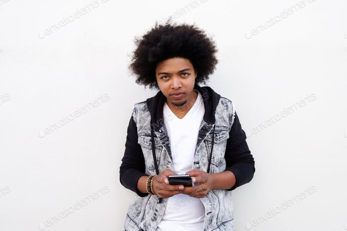 Cool young black guy with mobile phone