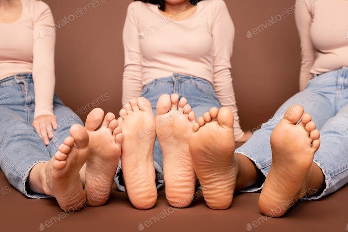 Bare feet and soles of contemporary young casual females of various ethnicities
