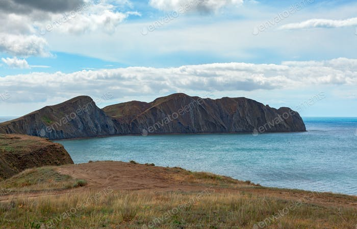 Bright blue sea in the Bay near the cape