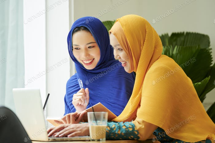 Young muslim women watching lection online