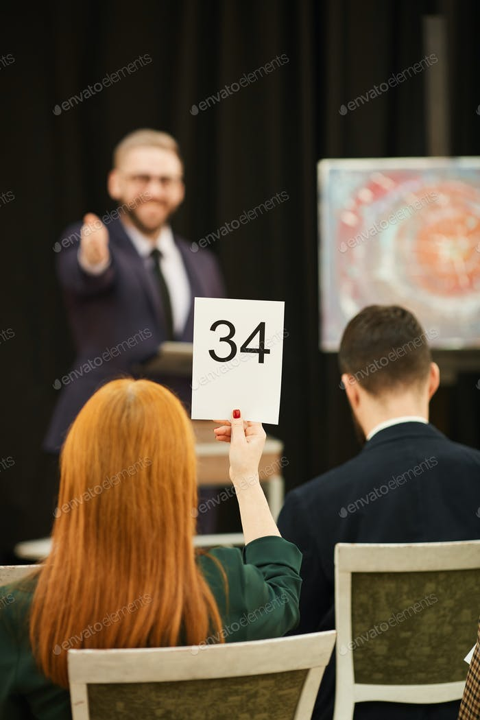 Woman with sign at auction