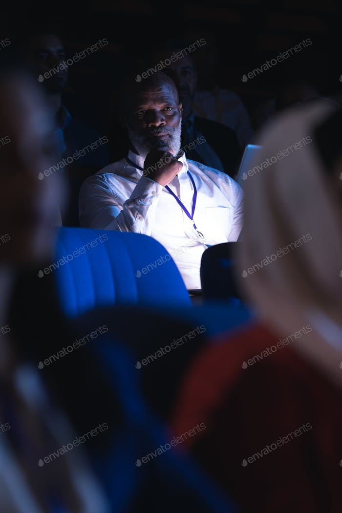 Businessman looking and thinking in the auditorium