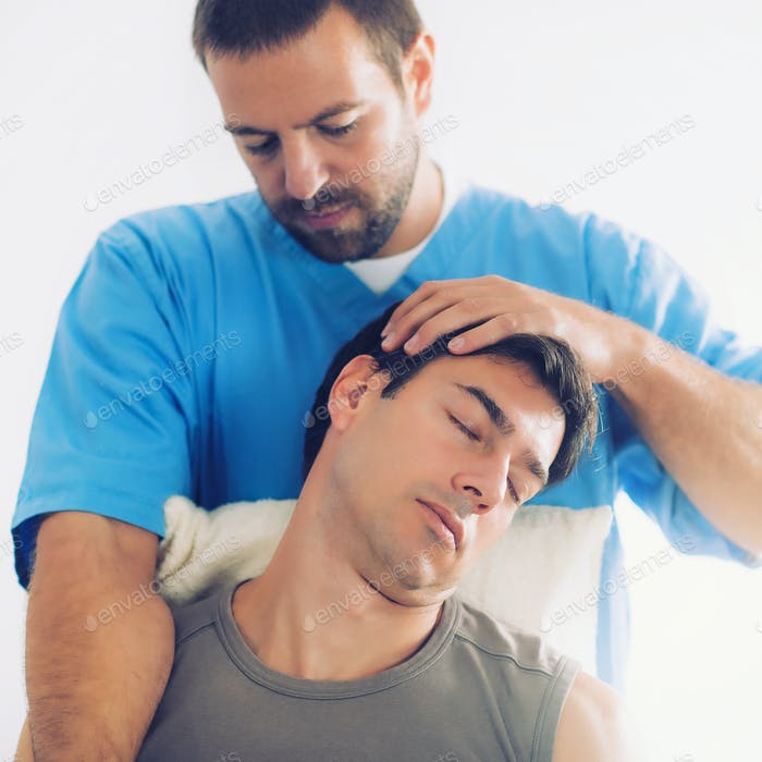 Physiotherapist Working With Patient Neck