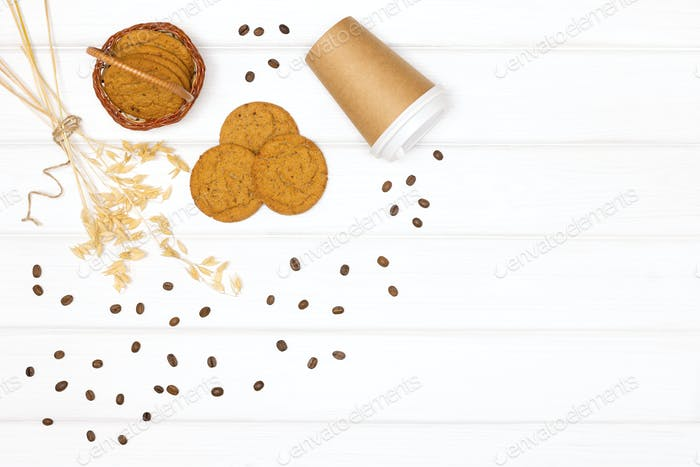 Oatmeal cookies, coffee cup and coffee beans. Healthy takeaway coffee dessert