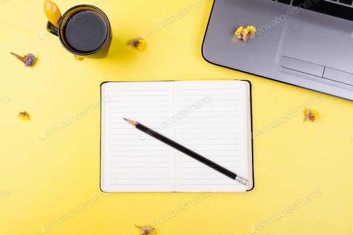 Notebook, coffee and flowers for female