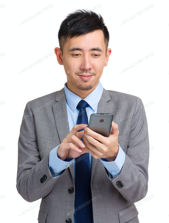 Businessman look at the cellphone