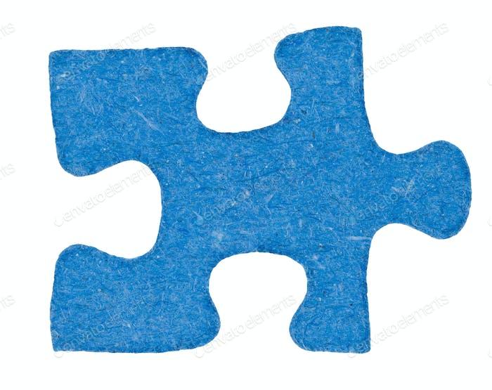 one cardboardblue piece of jigsaw puzzle