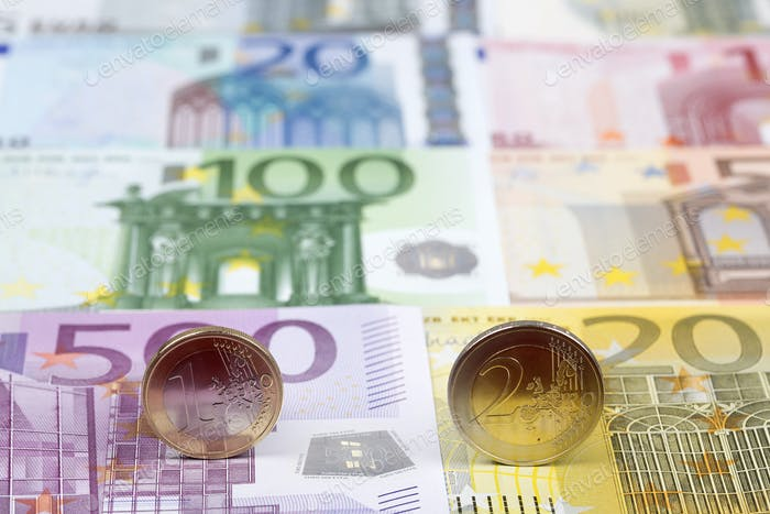 Euro coins on the background of banknotes