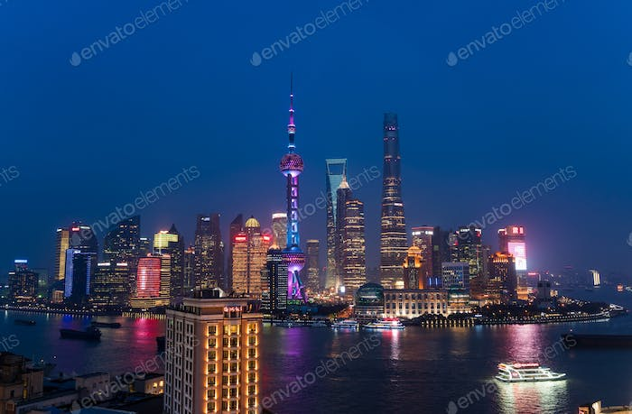 Skyline of the Pudong Financial district across Huangpu River at dusk, Shanghai, China.
