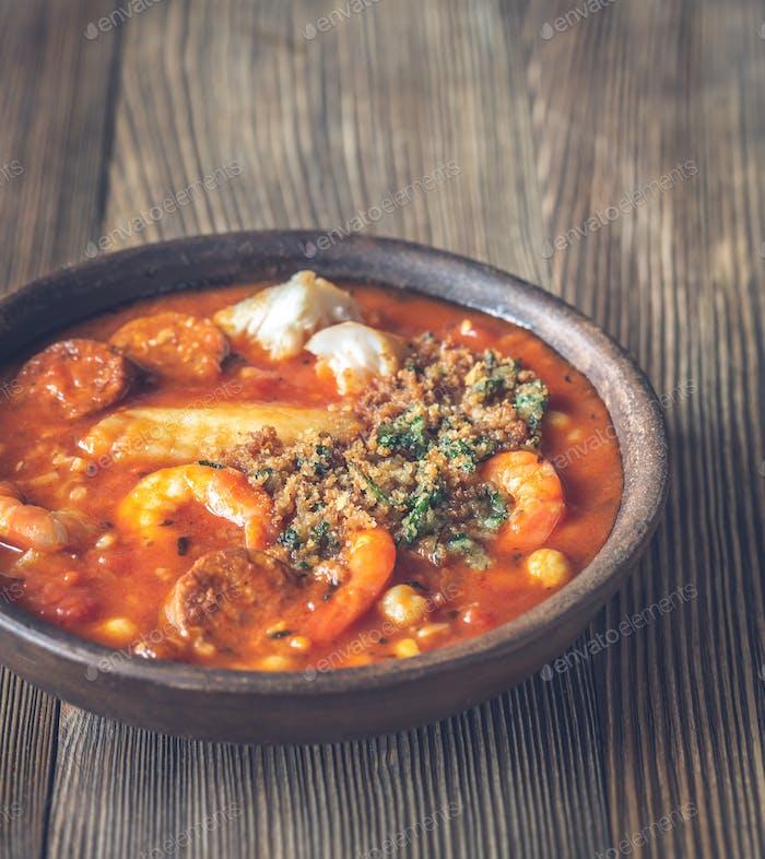 Portion of spanish fish and chorizo soup