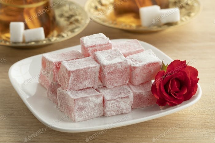 Turkish rose delight and a fresh rose