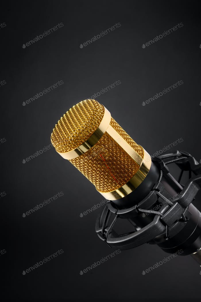 Gold studio microphone on black
