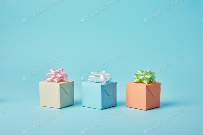 Different gifts with bows on blue background