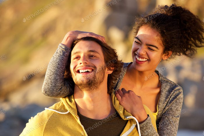 Close up attractive modern couple laughing together