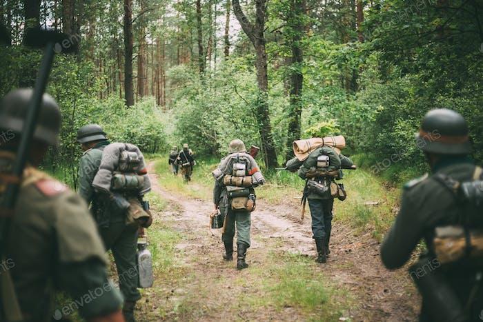 Unidentified Re-enactors Dressed As German Soldiers Marching Alo