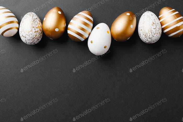 Golden eggs on black background