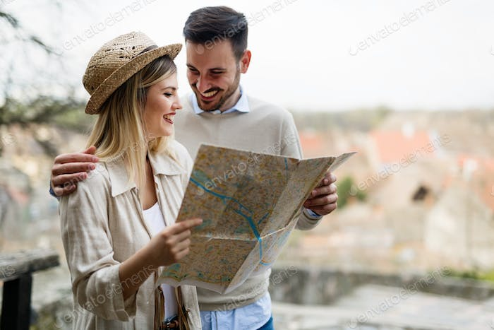 Tourist young couple using map as guide
