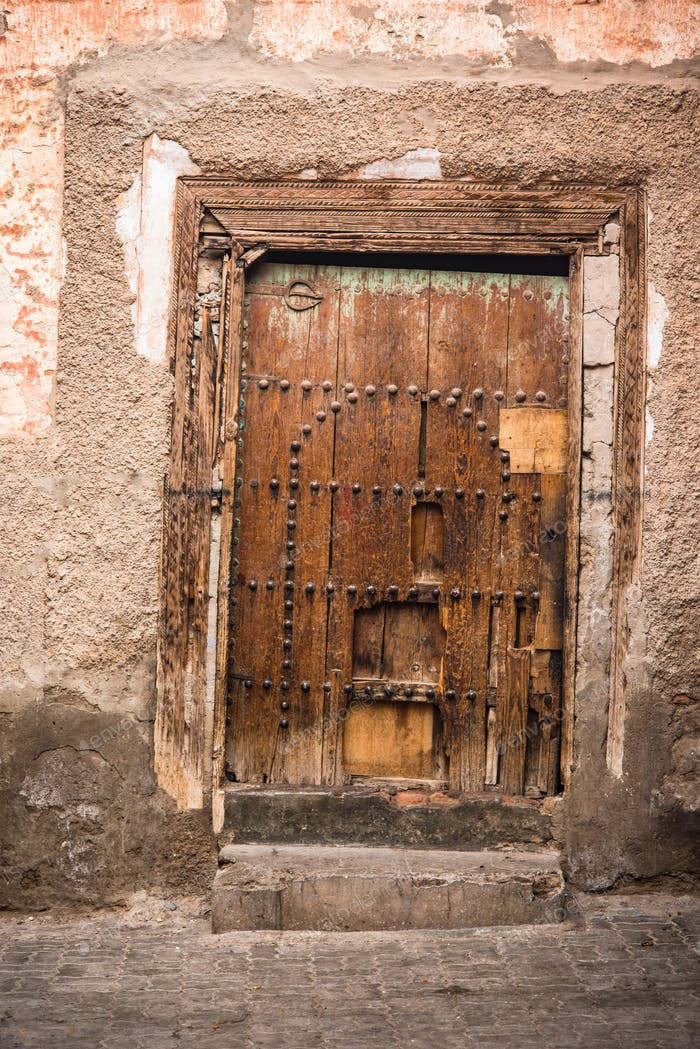 Rustic wooden house doors in Marrakesh,Morocco