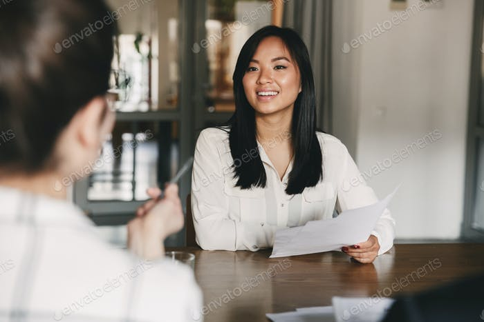 Business, career and placement concept - joyful asian woman smil
