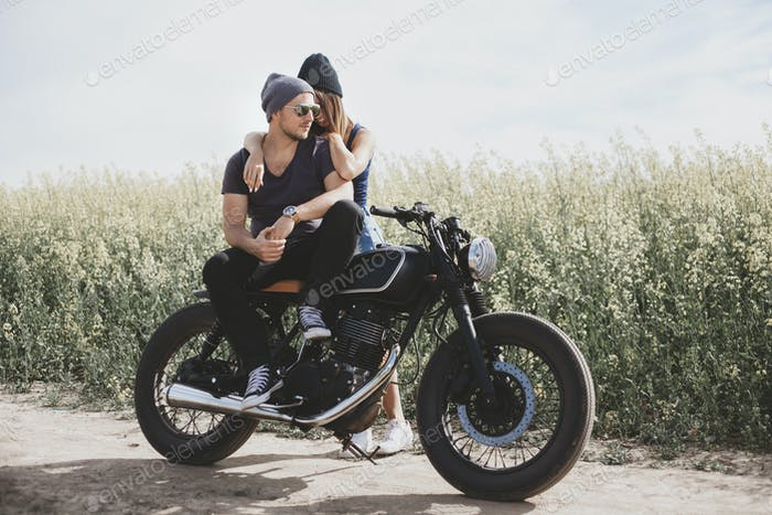 couple in field on motorcycle