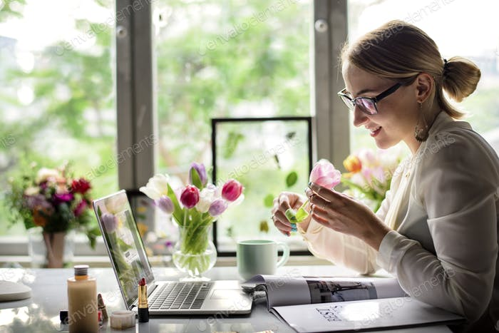 Businesswoman Holding Tulip Flower at Office Desk