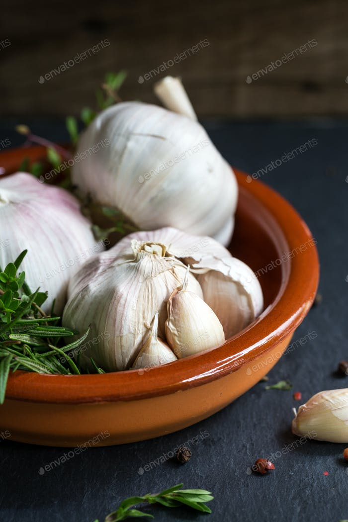 Garlic with Rosemary in a clay dish
