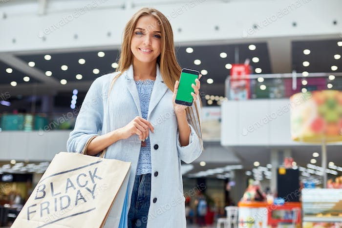 Young Woman presenting Shopping App