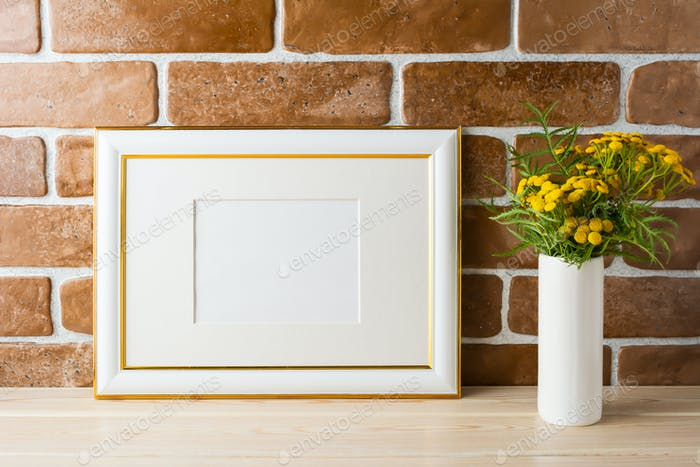 Gold decorated landscape frame mockup near exposed brick walls