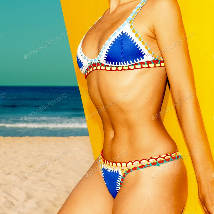 Model Beach style. Tanned body. Swimsuit fashion bikini