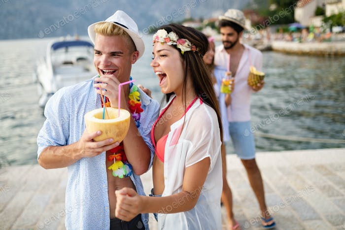 Group of happy friends partying and having fun on summer vacation