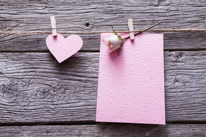 Valentine day background, card and paper heart on wood