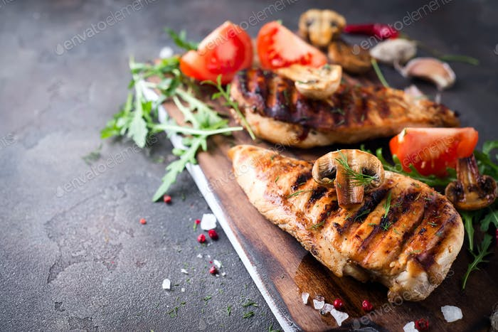 Closeup of two grilled chicken breasts