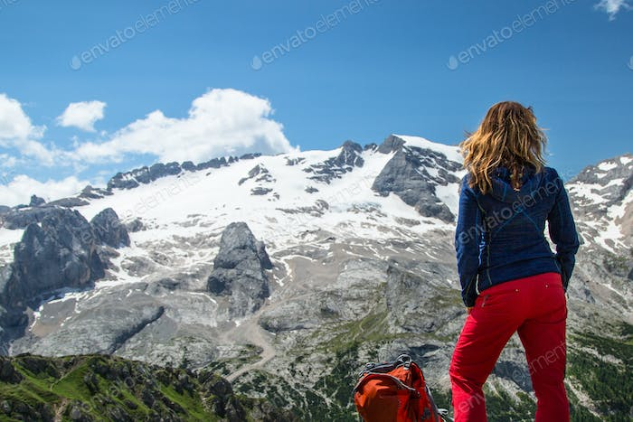 Hiking woman in the Alps, Dolomites, Italy