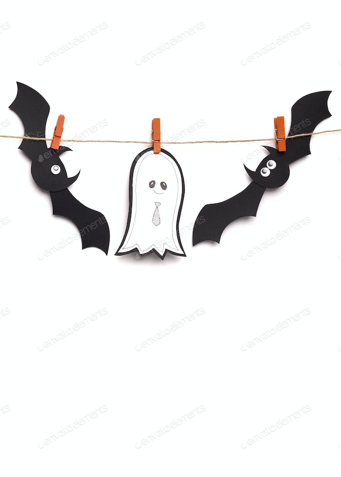 Halloween concept with paper silhouettes of bats and ghost