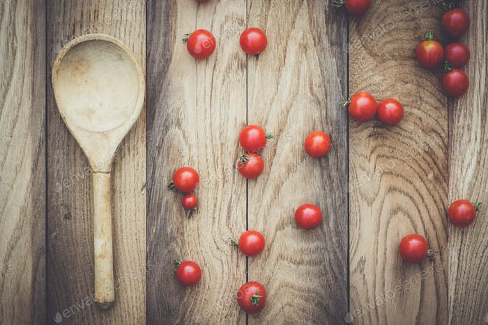 cherry tomatoes and wooden spoon