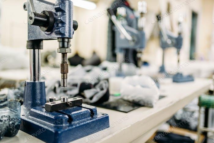 Clothing workshop, riverting machine closeup