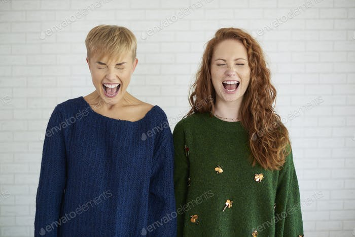 Front view of two excited girls shouting