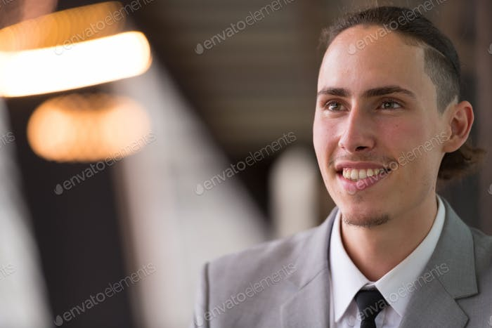 Happy Young Businessman Thinking