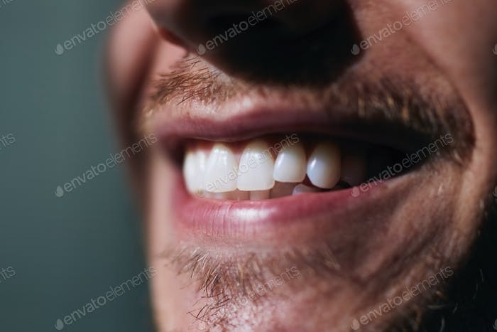 Toothy smile of young man