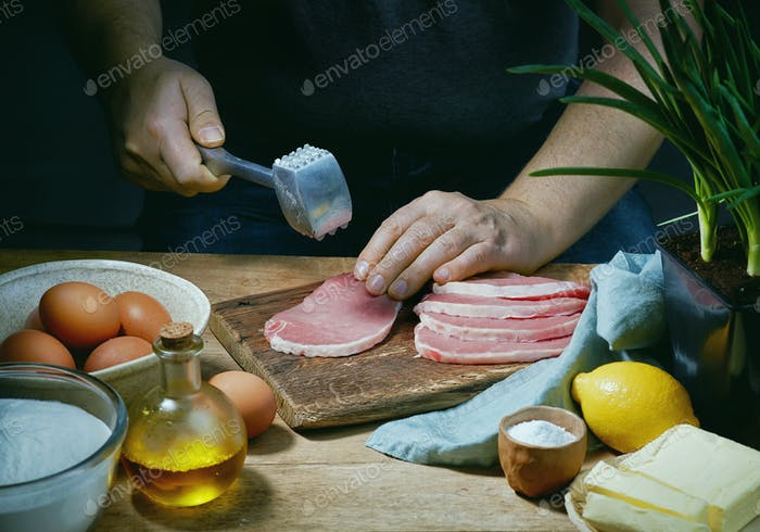 cook is preparing meat