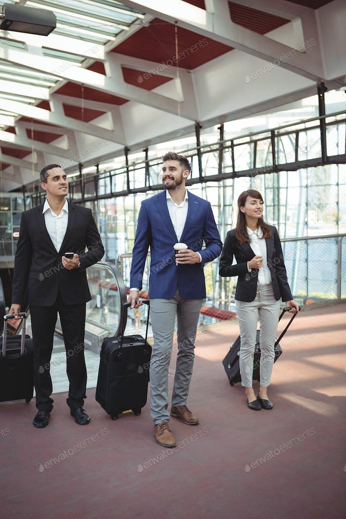 Businesses executives waiting on platform
